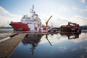 Save the Children's search and rescue vessel the Vos Hestia gets loaded ready for departure in Sicily, Italy.